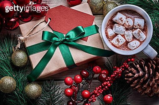 Top view of Christmas present on rustic wooden table with a cup of chocolate - gettyimageskorea
