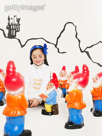 Portrait of little girl dressed up as Snow White with the seven dwarfs - gettyimageskorea