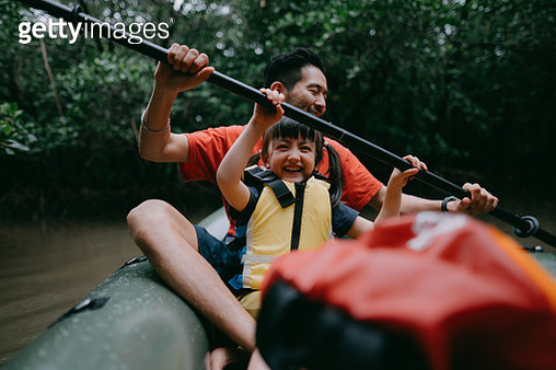 Japanese father and 4 year old mixed race daughter paddling a kayak together in mangrove swamp, Iriomote Ishigaki National Park of the Yaeyama Islands, Okinawa, Japan - gettyimageskorea