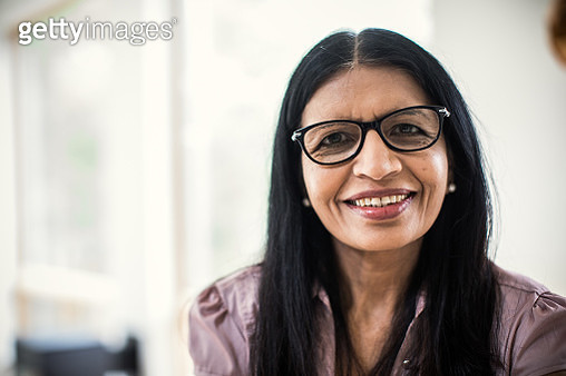 Portrait of senior woman at home - gettyimageskorea