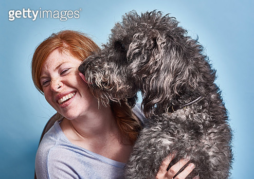 Red headed British female with her dog - gettyimageskorea