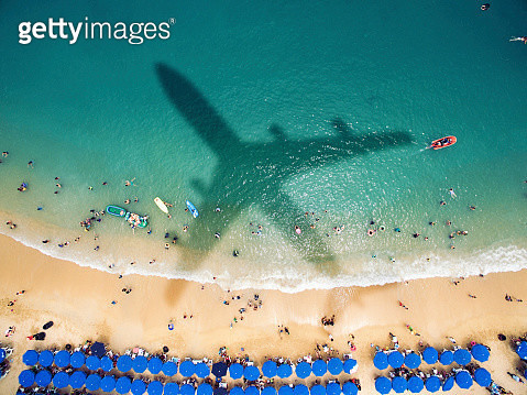 Airplane's shadow over a crowded beach - gettyimageskorea