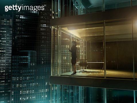 Woman in an office by night - gettyimageskorea
