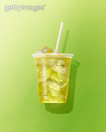 Cup of Green Tea on Green Background - gettyimageskorea