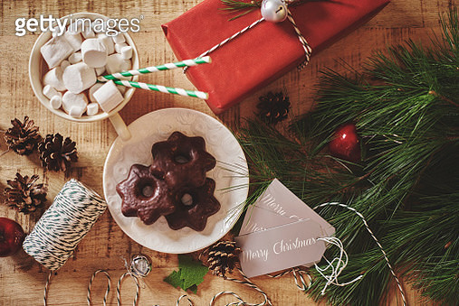 Overhead view of christmas decorations, hot chocolate and cookies - gettyimageskorea