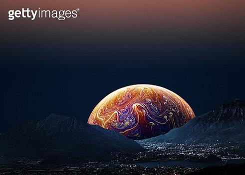 Alien sunrise behind mountains landscape - gettyimageskorea