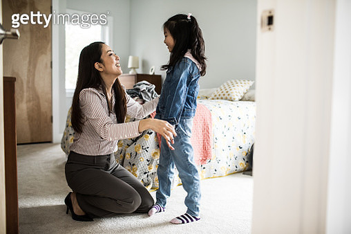 Mother getting daughter (6 yrs) ready for school - gettyimageskorea
