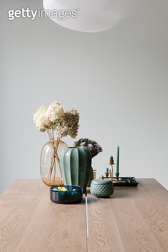 home decor - still life with vases, flowers, and candlestick - gettyimageskorea
