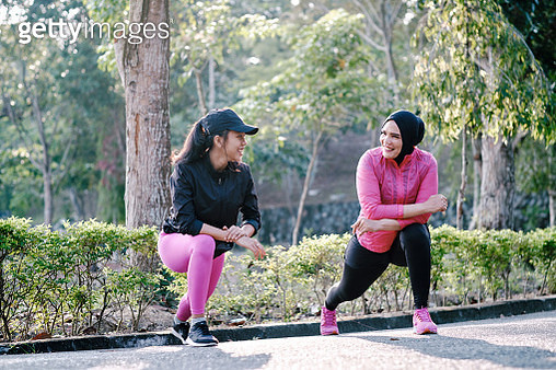 Mother and Daughter Stretching Out Before Running - gettyimageskorea