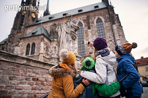 Mother with three kids sightseeing city of Brno. Family is photographing the Cathedral of St. Peter and Paul in the old town of Brno.Nikon D850 - gettyimageskorea