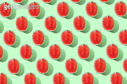 Repeated watermelon on the green background - gettyimageskorea