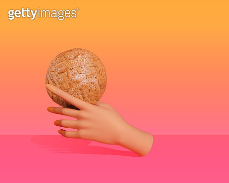 Floating mannequin hand holding a large homemade, vegan, gluten free peanut butter cookie against a warm, bright gradient background - gettyimageskorea