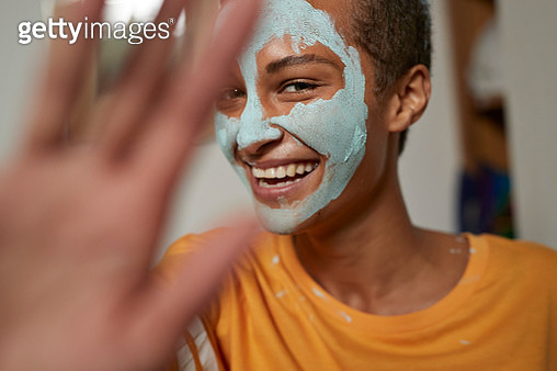 Close-up of smiling woman gesturing at home - gettyimageskorea