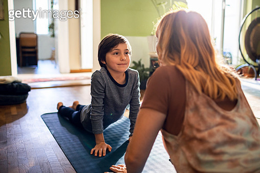 Mother teaching her son Yoga - gettyimageskorea