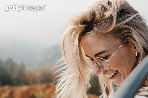 Portrait of smiling young woman outdoors - gettyimageskorea