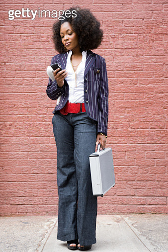 Stylish woman with cellphone - gettyimageskorea