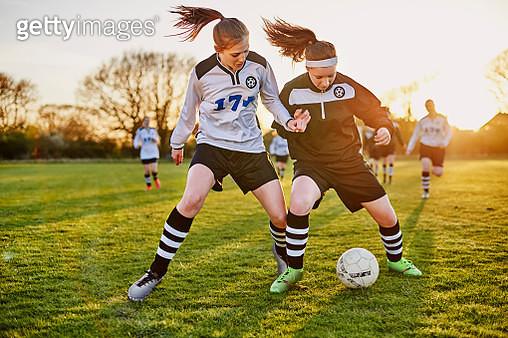 Female footballers tackling - gettyimageskorea