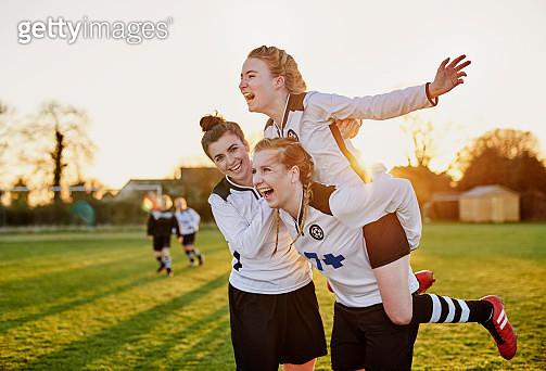 Female footballers celebrating goal - gettyimageskorea
