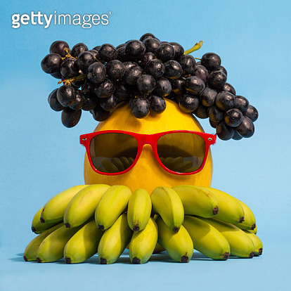 Close-Up Of Sunglasses On Fruits Over Blue Background - gettyimageskorea