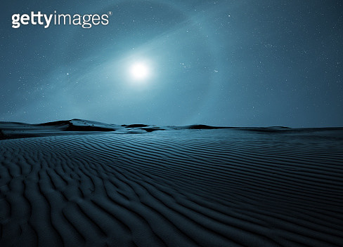 Halo around full moon above the desert - gettyimageskorea