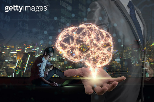 Double exposure of Businessman hand holding the brain base on sparkle over Asian businessman using the smart mobile phone showing the Stock market chart , Artificial Intelligence or AI concept - gettyimageskorea