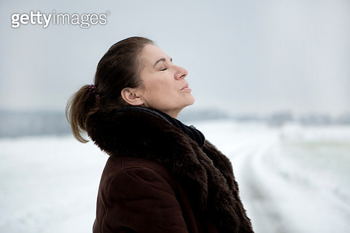Portrait of mature woman in winter - gettyimageskorea