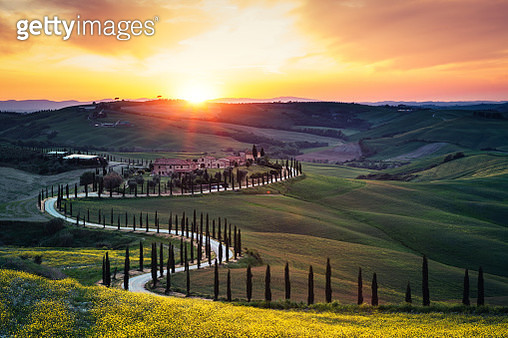 Tuscany landscape with winding country road at sunset (Val D'orcia, Italy). - gettyimageskorea
