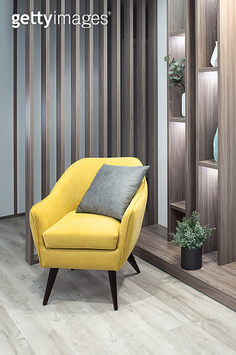 part of living room interior with yellow chair side view close up - gettyimageskorea