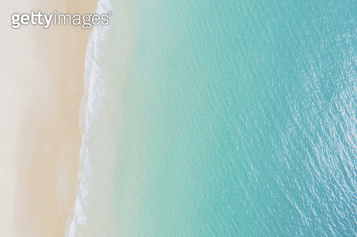 Aerial view on empty beach and turquoise sea. Directly above. Drone view. - gettyimageskorea