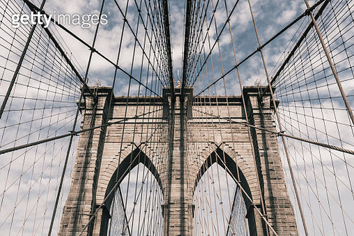 Low angle view of steel cables on Brooklyn Bridge against sky, New York City, New York, USA - gettyimageskorea
