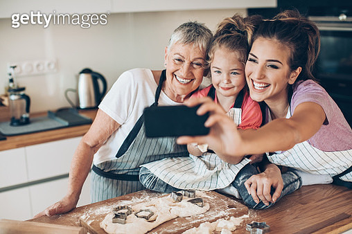 Grandmother, mother and daughter making selfie in a messy kitchen - gettyimageskorea