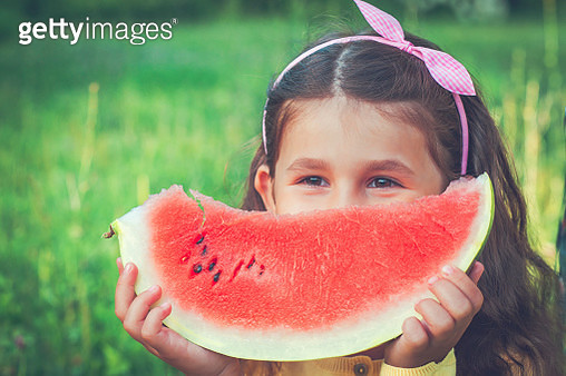 Child with watermelon - gettyimageskorea