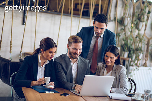 Business people cooperating over new business project using laptop - gettyimageskorea