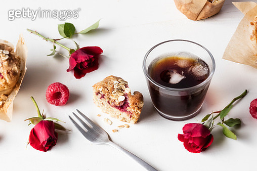 Raspberry muffin and glass of iced coffee - gettyimageskorea