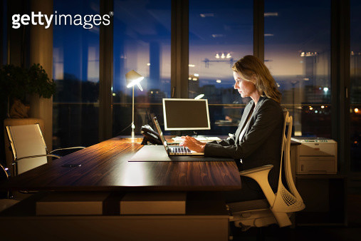 Mature Business Woman Working Late - gettyimageskorea