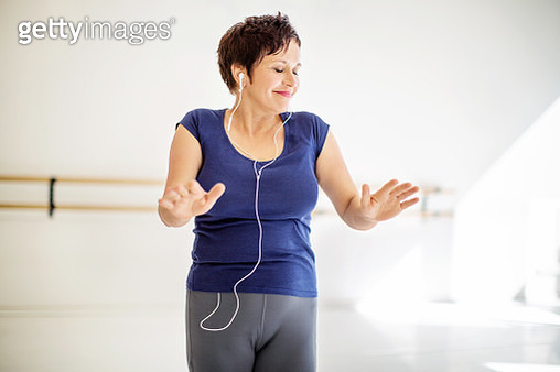 Woman practicing fitness dance with music - gettyimageskorea