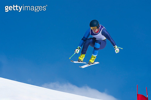 Young Man Jumping on the Red Gate During Downhill Ski Race - gettyimageskorea