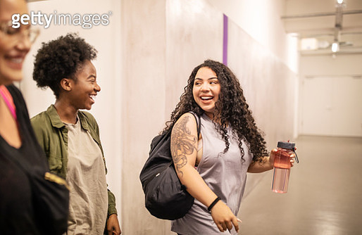 Smiling multi-ethnic females entering dance studio. Group of women walking into a fitness dance class. - gettyimageskorea