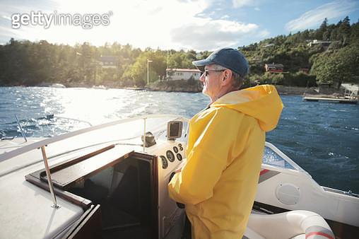 Senior man sailing on boat - gettyimageskorea