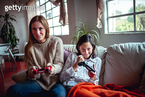 Mother and daughter are playing video games. Weekend activates - gettyimageskorea