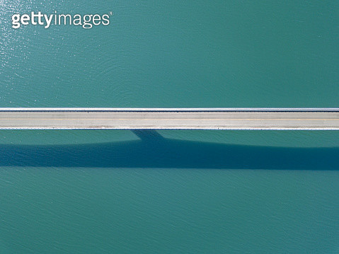 Aerial view of cars on bridge over river - gettyimageskorea