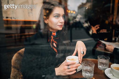 Woman drinking coffee in cafe in Paris, France - gettyimageskorea
