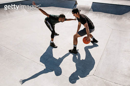 Basketball players dribbling and defending - gettyimageskorea