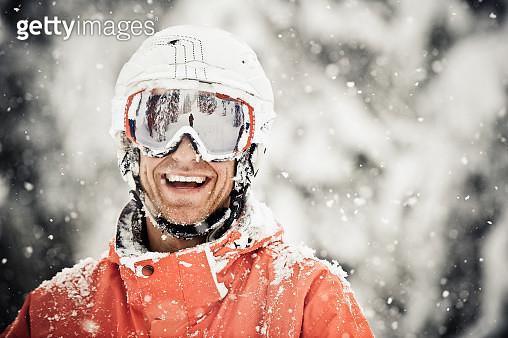 Skier Man Smiles as The Snow Falls - gettyimageskorea
