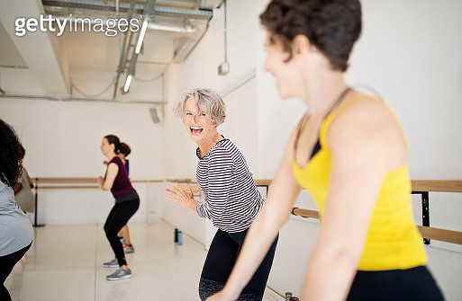 Cheerful women dancing with at health club. Females enjoying a dance routine in fitness studio. - gettyimageskorea