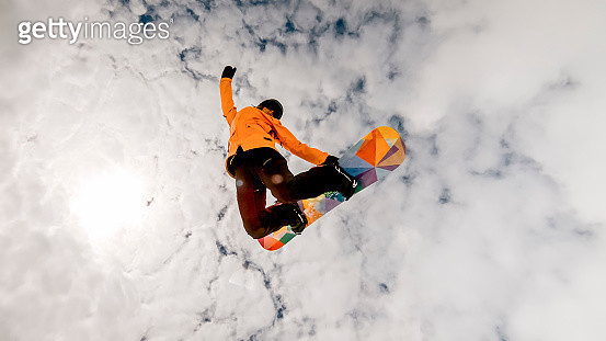 Woman jumping in air with snow board - gettyimageskorea