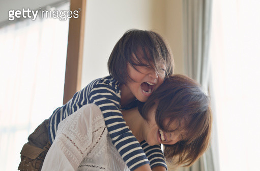 Mother giving daughter a piggyback ride,Girl of five years,Japan - gettyimageskorea