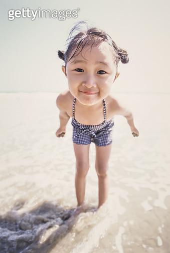 Little girl having fun at the beach - gettyimageskorea