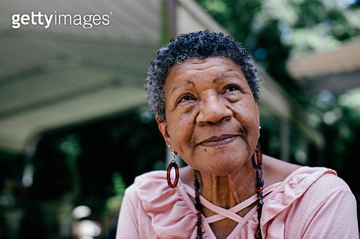 Close-up portrait of senior black woman looking thoughtful - gettyimageskorea