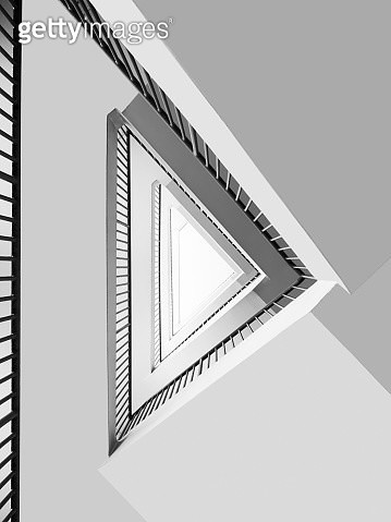 Abstract Look-Up View Of Triangular Staircase Raillings In Black And White - gettyimageskorea